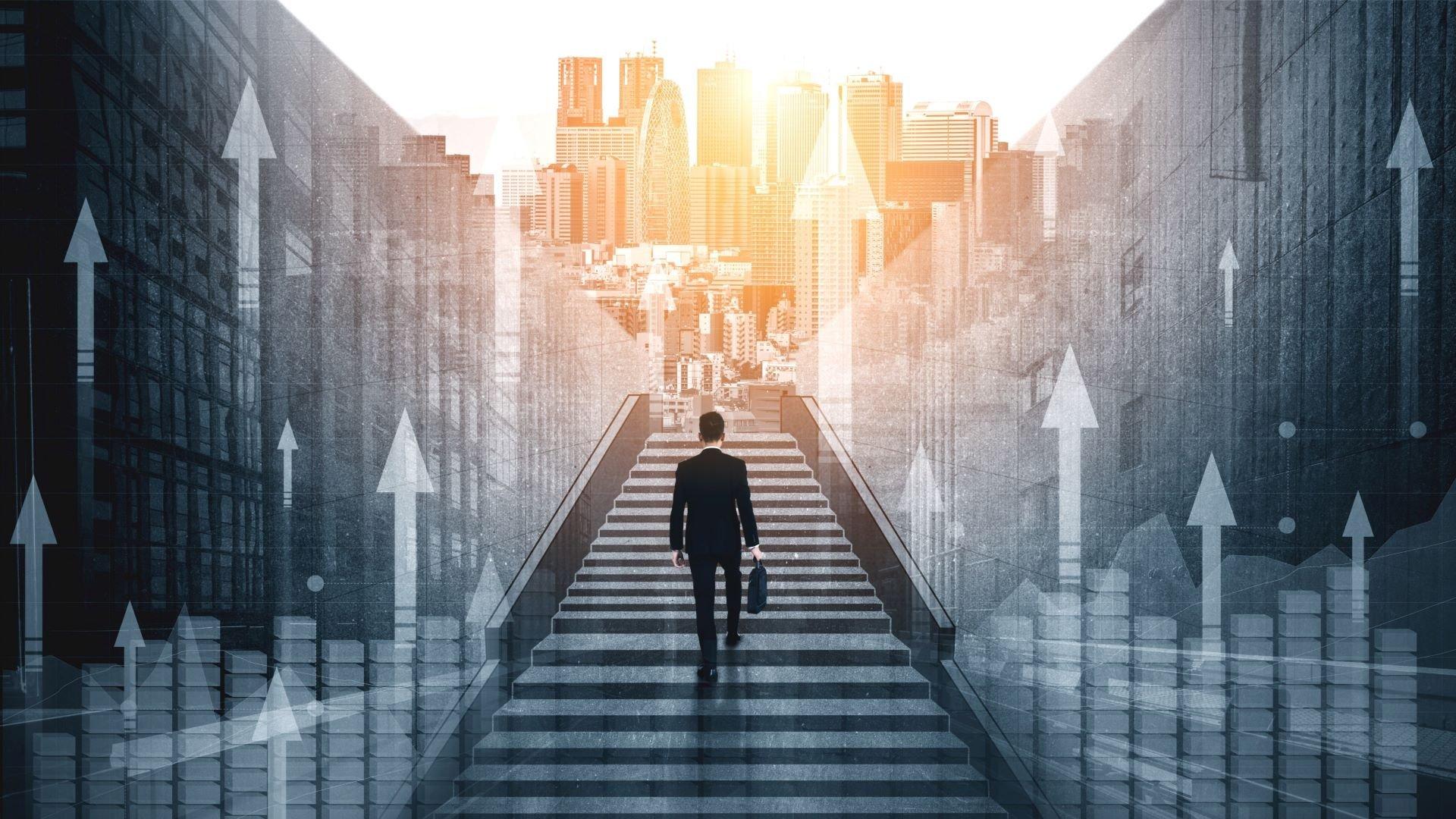 Businessman climbing a staircase to success