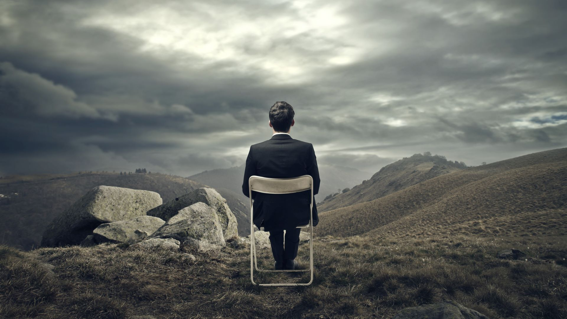 Businessman dreaming of his company success out a vast landscape