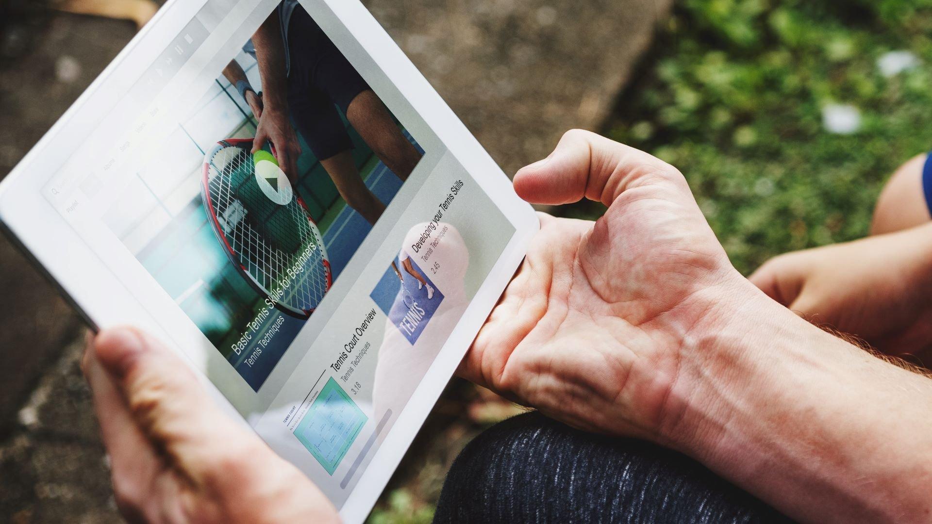 Customers watching tennis marketing videos on an iPad