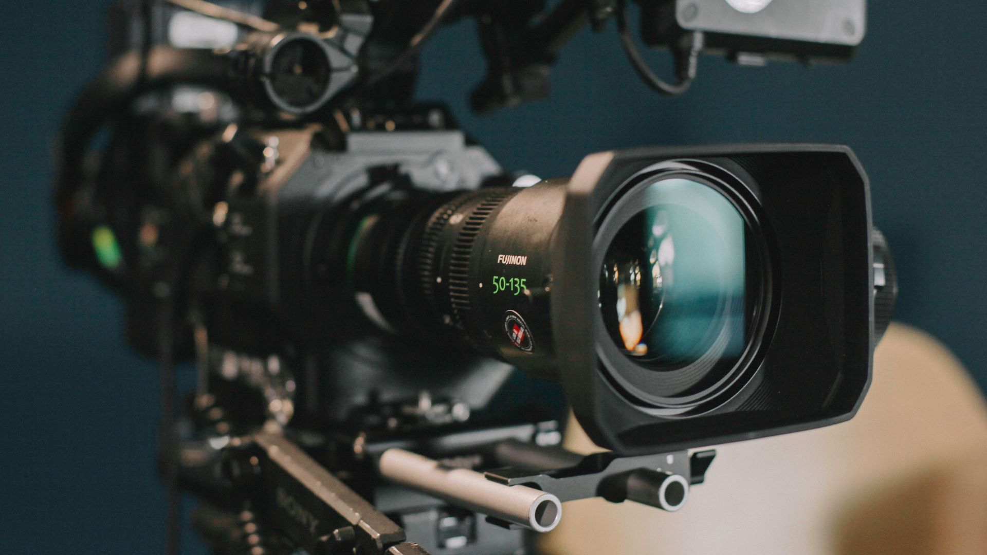 Professional video camera preparing for a franchise business shoot