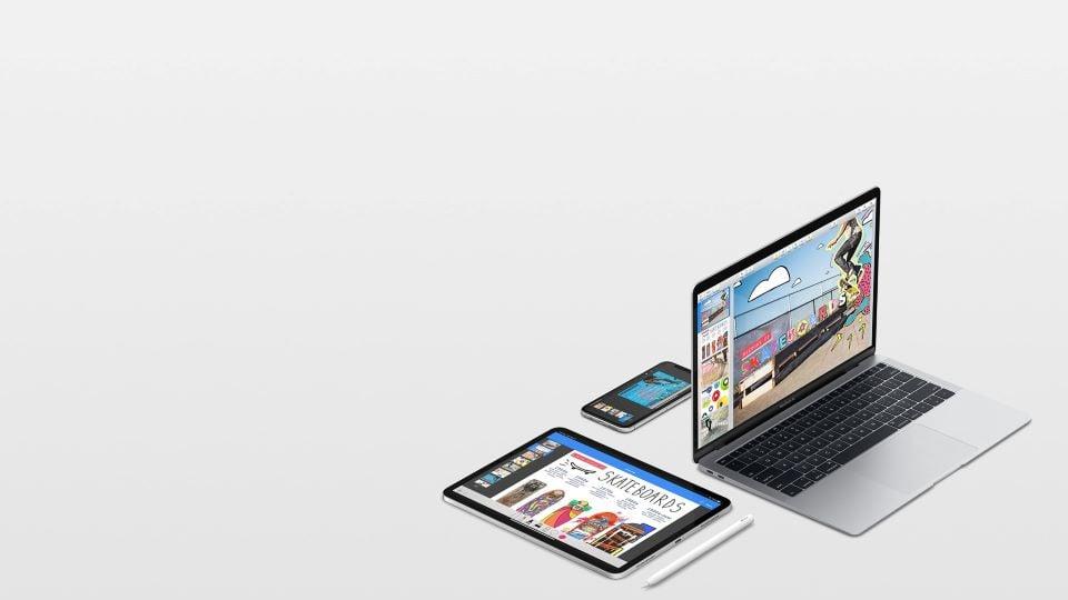 Apple branded Macbook, iPad, and iPhone displaying videos