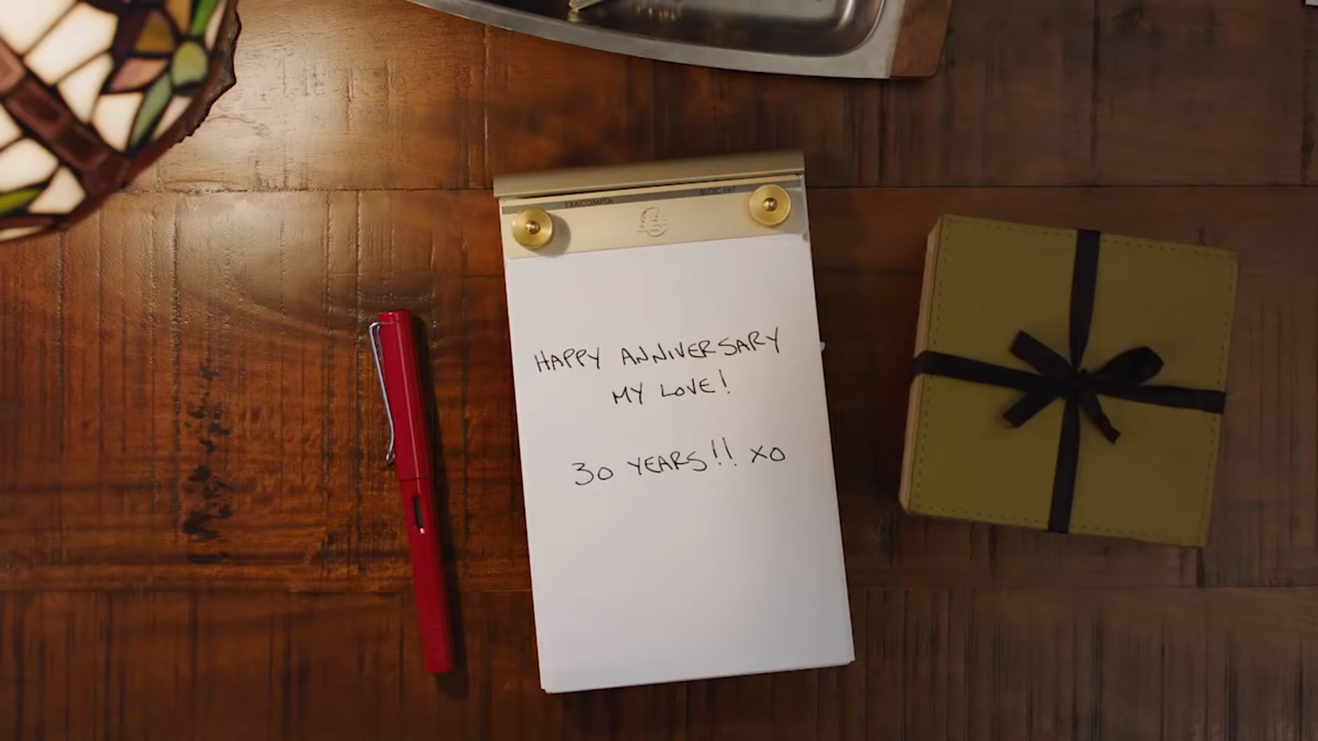 Notepad with 'happy anniversary' message from branded company video