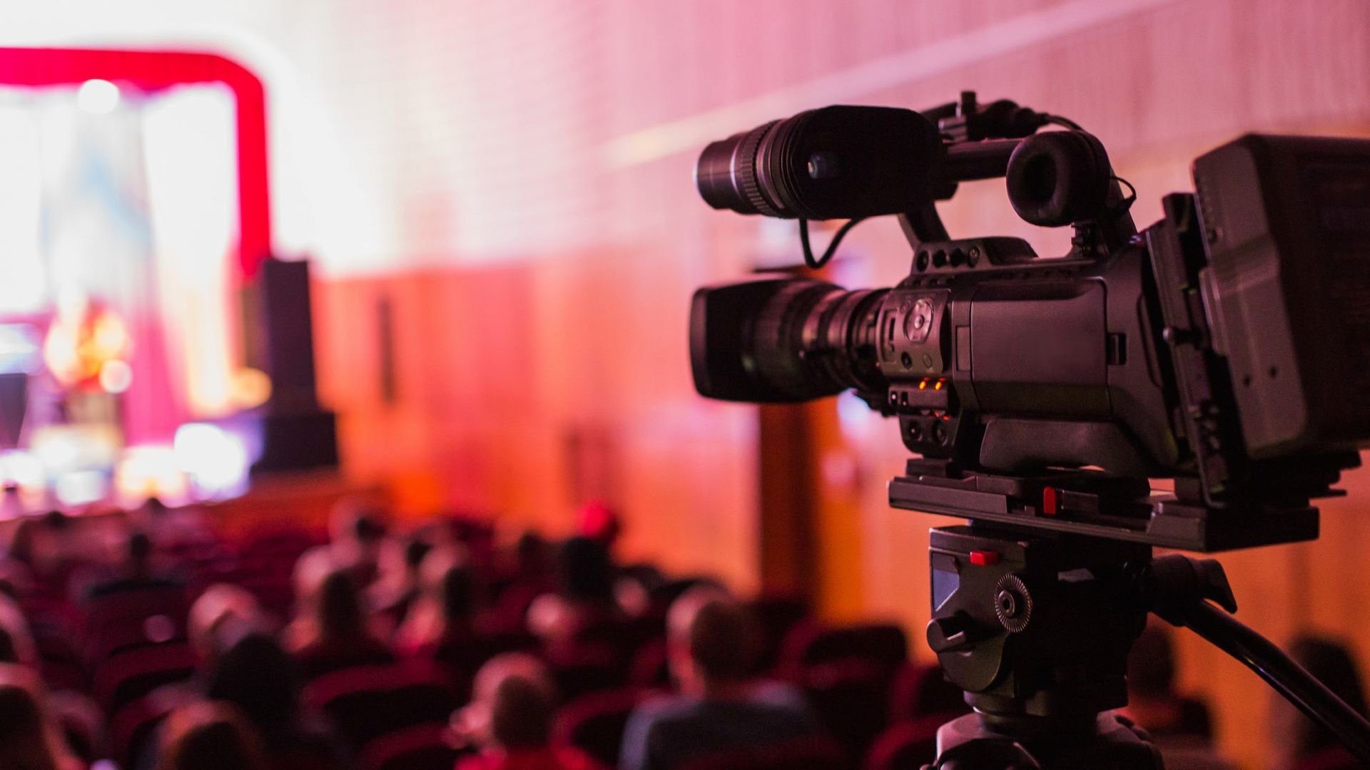 Professional video camera filming a business event marketing video