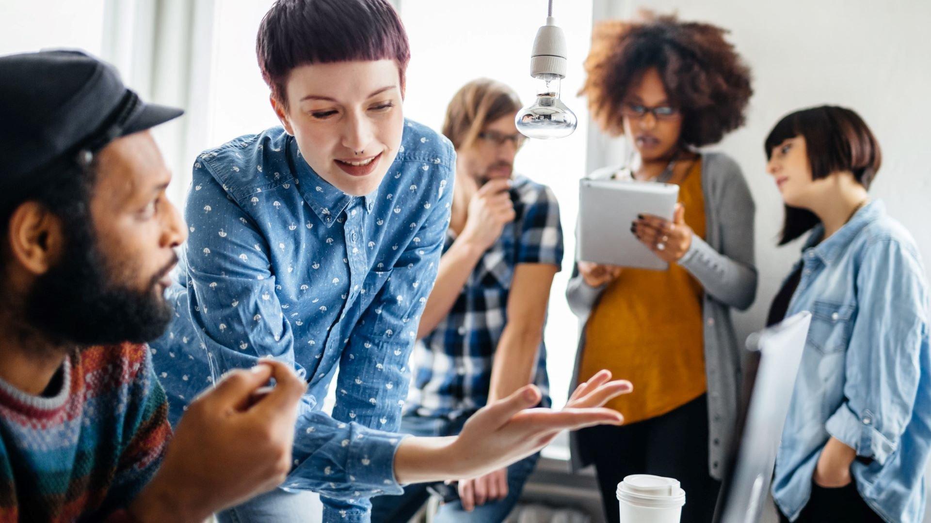 Diverse marketing team brainstorming video concept ideas