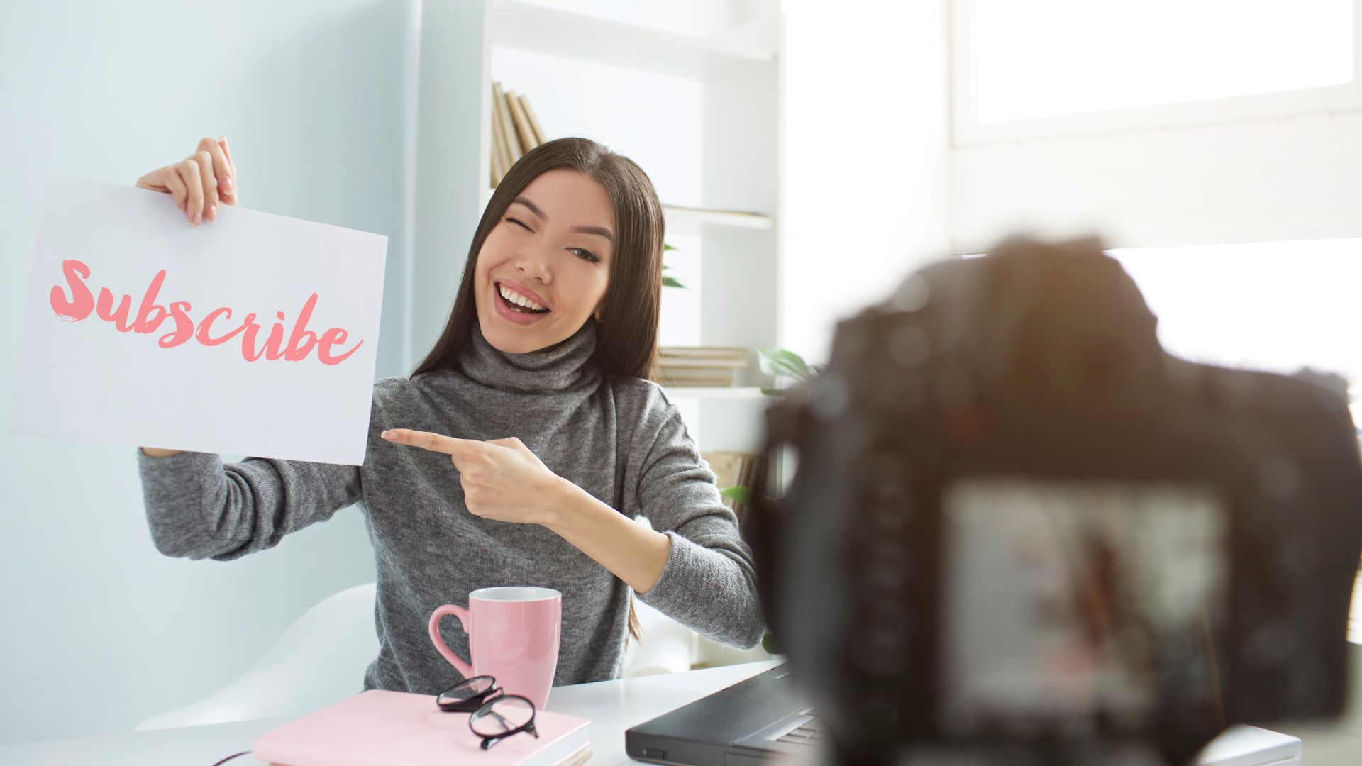 Youtube vlogger strategically marketing to viewers and asking them to subscribe